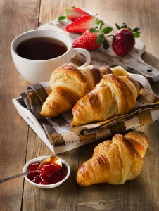 Fresh croissants with coffee cup for a breakfast.